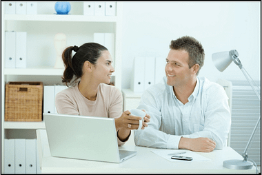 Couple in an office preparing to work cooperatively