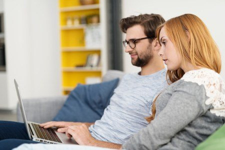 Couple on computer in Online Marriage Counseling