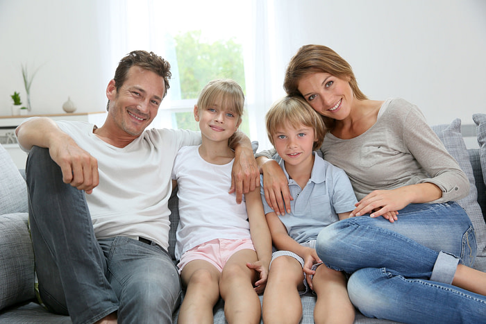 29377869 - happy family relaxing on couch at home