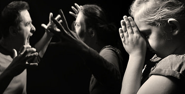 31728796 - child prays for peace in the family on the background of quarreling parents.