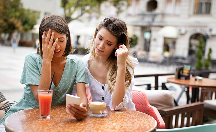 Desperate woman getting support from her best friend outdoor