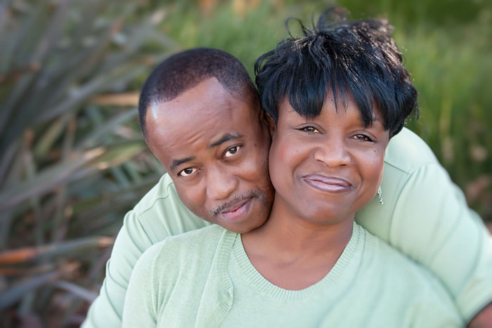 6098884 - attractive and affectionate african american couple posing in the park.